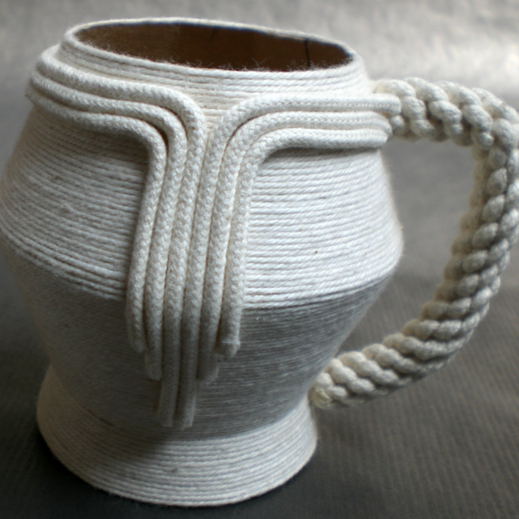Paper and string tea cup